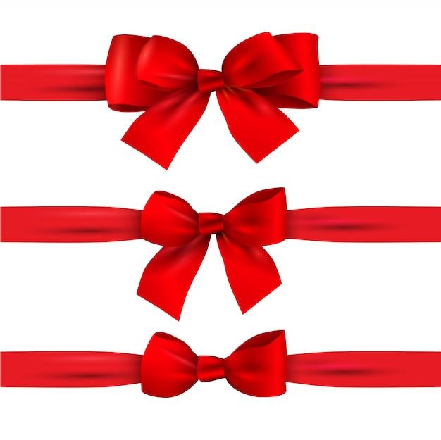 白で隔離される水平方向のリボンと赤の弓のセット Premiumベクター
