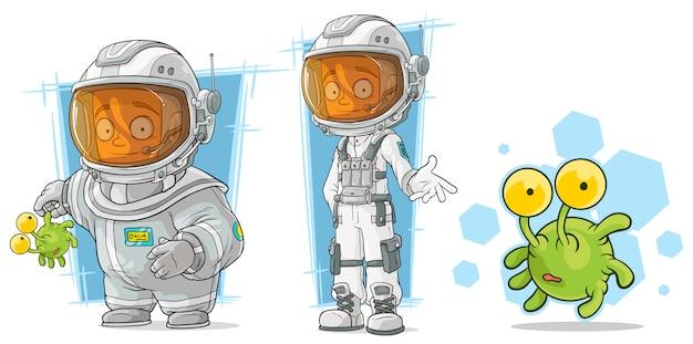 エイリアンのキャラクターと漫画宇宙飛行士 Premiumベクター