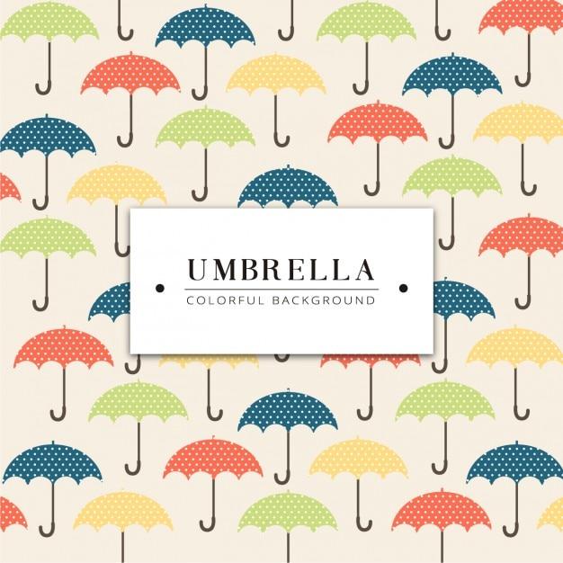 色とりどりの傘の背景デザイン 無料ベクター