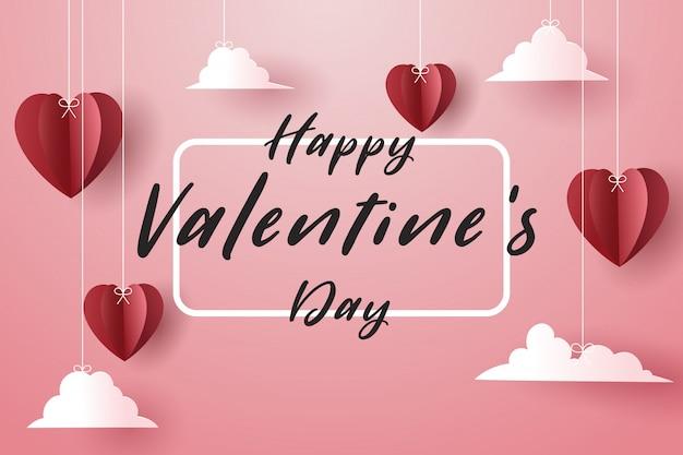 赤い紙のハートと空の白いボーダーカード、バレンタインの日。 Premiumベクター