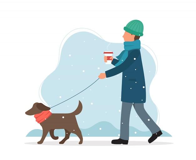 冬に犬を歩く男。 Premiumベクター