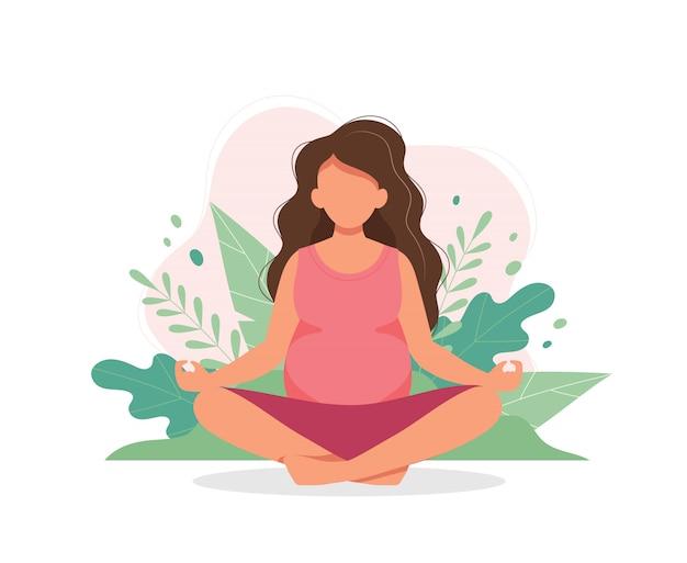 Беременная женщина занимается йогой с листьями Premium векторы