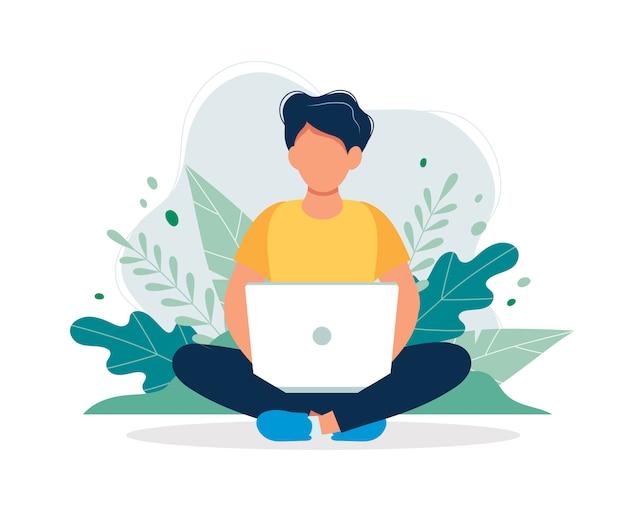 自然と葉に座っているラップトップを持つ男。 Premiumベクター