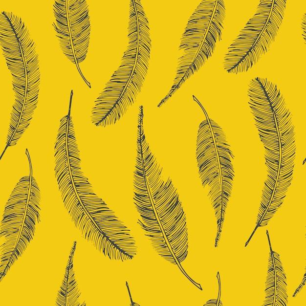 Бесшовные этнической картины с перьями на желтом Бесплатные векторы