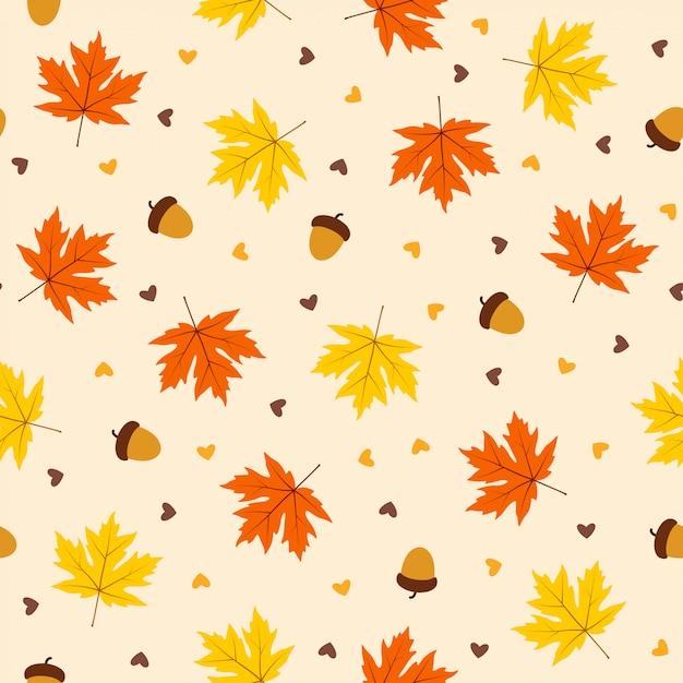 オレンジ色の背景に葉と秋のシームレスパターン Premiumベクター