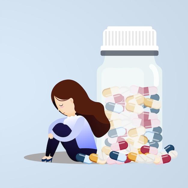 Грустная женщина сидит возле таблетки бутылки. Premium векторы