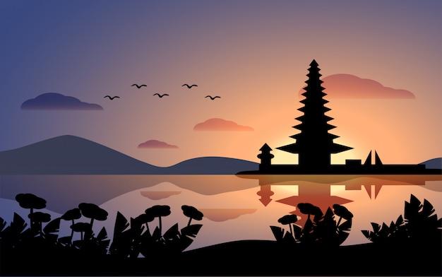 寺院と湖のあるバリ島の日没の風景 Premiumベクター
