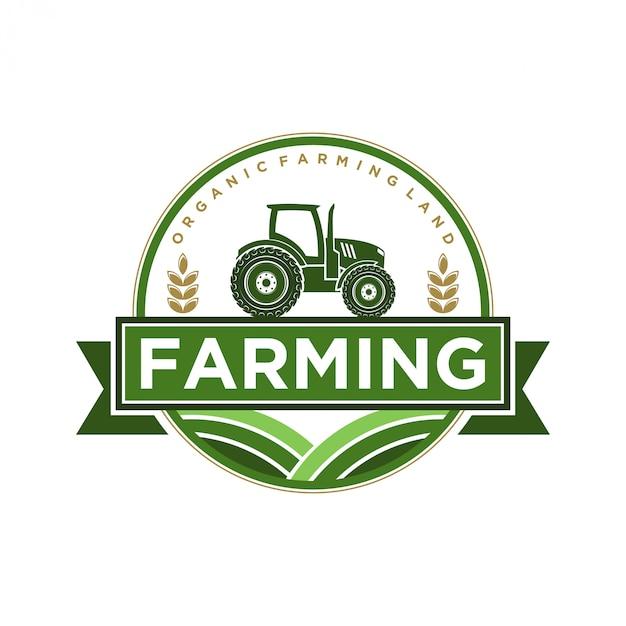 トラクターとシャベルの要素を含む農業産業のためのロゴ Premiumベクター