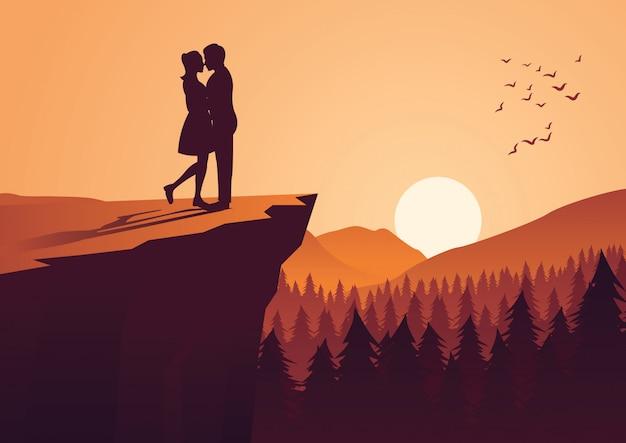 Пара обнимаются вместе на скале Premium векторы