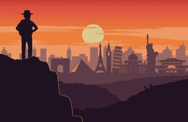 Авантюрист стоит на вершине горы Premium векторы