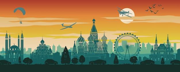 Знаменитая достопримечательность россии в декорациях, путешествиях, силуэтах и закатах красного и зеленого цвета Premium векторы
