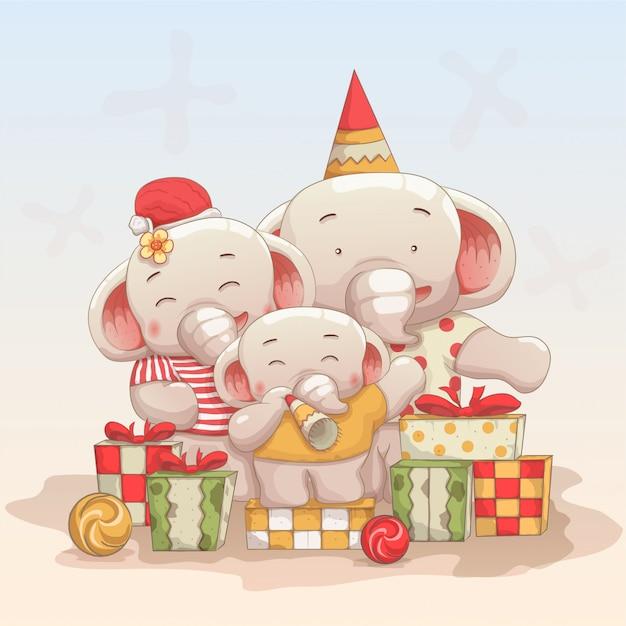 Счастливая семья слонов празднуют рождество и новый год Premium векторы