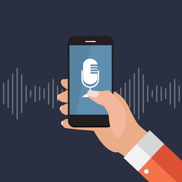 マイクボタンとフラットスタイルのインテリジェントな技術を持つ携帯電話を持つ手 Premiumベクター