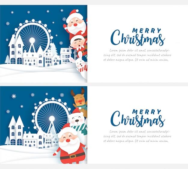 クリスマスカードの雪の村でサンタとのクリスマスのお祝い Premiumベクター