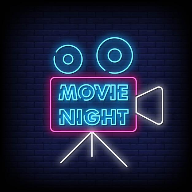 レンガの壁に映画の夜のネオン看板 Premiumベクター