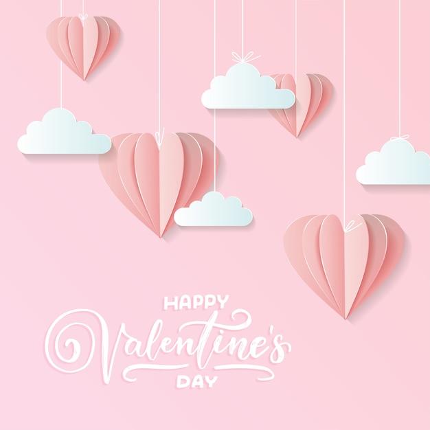 クラフトペーパーデザインのバレンタイン、ピンクのハートが含まれているし、雲が上に刺して保持している Premiumベクター