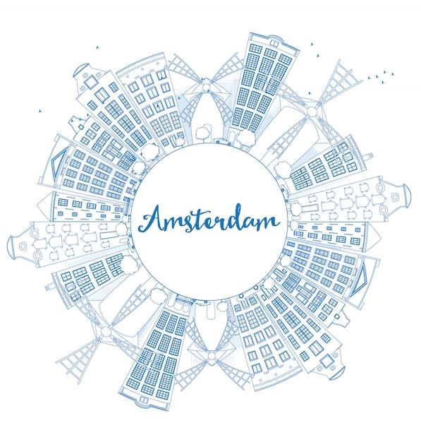 青い建物とコピースペースでアムステルダムの街のスカイラインの概要を説明します。 Premiumベクター