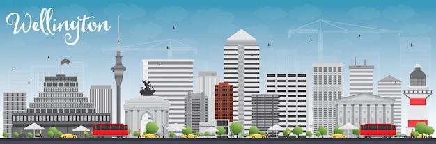 灰色の建物と青い空とウェリントンのスカイライン。 Premiumベクター