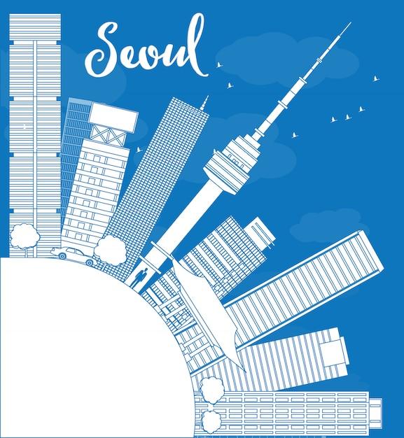 青い建物とコピースペースとソウルのスカイラインの概要 Premiumベクター