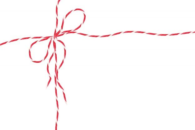 分離された赤いひもロープ、弓でクリスマスパッケージ装飾文字列。 Premiumベクター