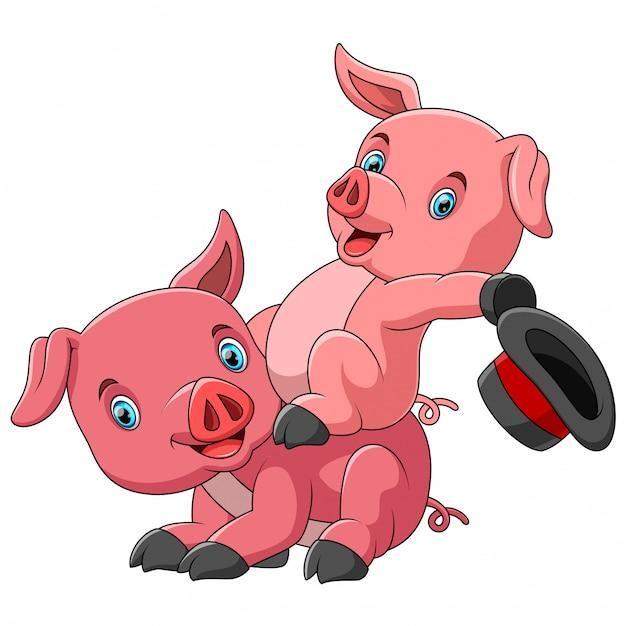 一緒に遊ぶ豚のかわいい漫画家族 Premiumベクター