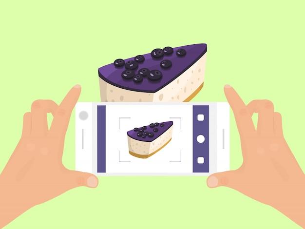 電話で手は、ケーキフードイラストの写真を撮る。パイのスマートフォン写真。ケーキ電話写真の平面図。 Premiumベクター