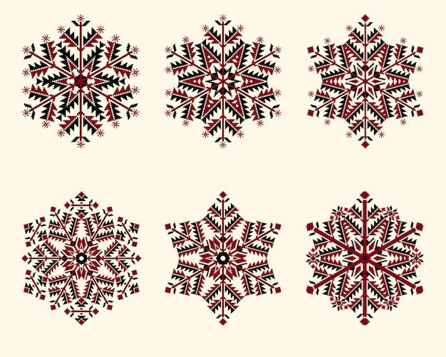 雪片を設定します。クリスマスと新年のデザインのための優雅な雪。 無料ベクター
