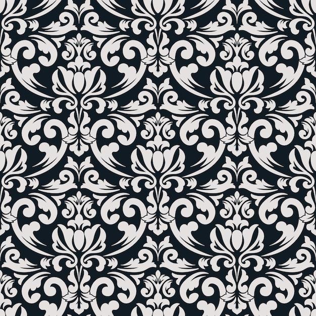 ダマスク織のシームレスなパターン背景。古典的な豪華な昔ながらのダマスク織の飾り、壁紙、テキスタイル、ラッピングのロイヤルビクトリア朝のシームレスなテクスチャ。絶妙な花のバロックテンプレート。 無料ベクター