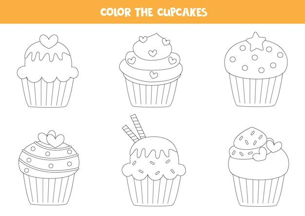 かわいいカップケーキの色セット。子供のための着色ページ。 Premiumベクター