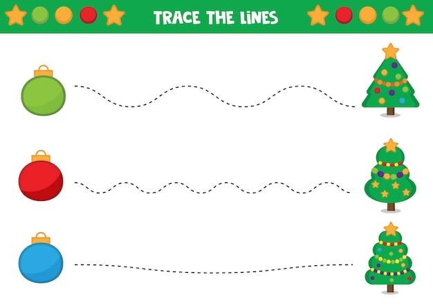 手書きの練習。クリスマスボールとモミの木。子供のための教育用ワークシート。子供向けのゲーム。 Premiumベクター