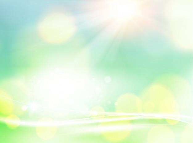緑のボケ味の抽象的な光の背景。 Premiumベクター