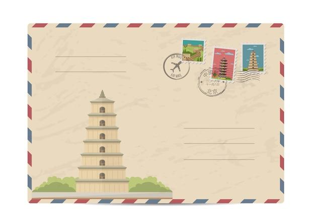 Старинный почтовый конверт с марками китая Premium векторы