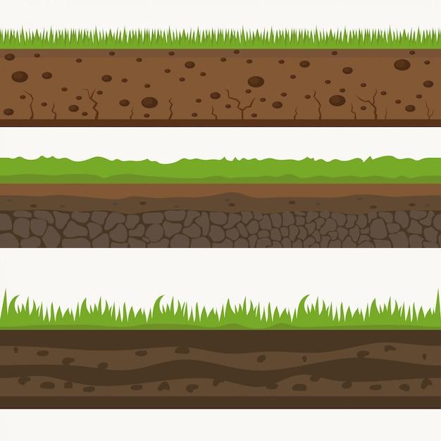 土壌シームレス層グランド層。土の上の石と草。 Premiumベクター
