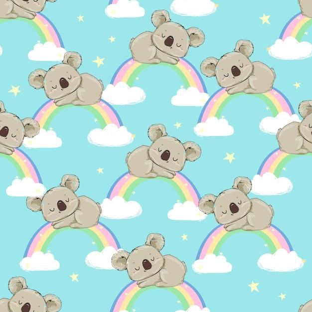 手描きのかわいいコアラと虹のシームレスパターン Premiumベクター