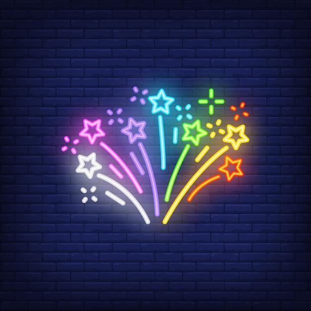 レンガの背景に多色の花火。ネオンスタイル 無料ベクター