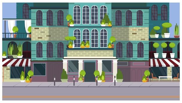 美しい建物と植物を持つ空の街の通り 無料ベクター