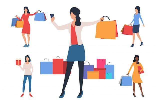 買い物袋を持つ若い女性のコレクション 無料ベクター