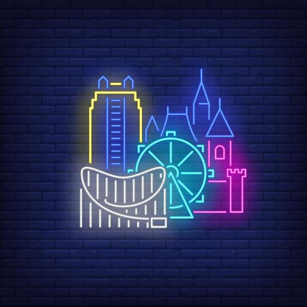 Здания города орландо и неоновая вывеска диснейленда. осмотр достопримечательностей, туризм, путешествия. Бесплатные векторы