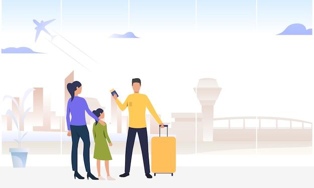 Пара с дочерью стоит в аэропорту Бесплатные векторы
