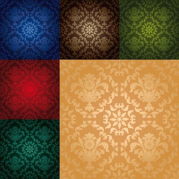 花のシームレスな壁紙パターンを設定します Premiumベクター