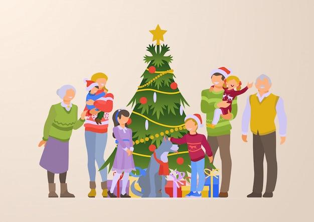 クリスマスツリーとギフトボックスフラット図の近くに幸せな家族 無料ベクター