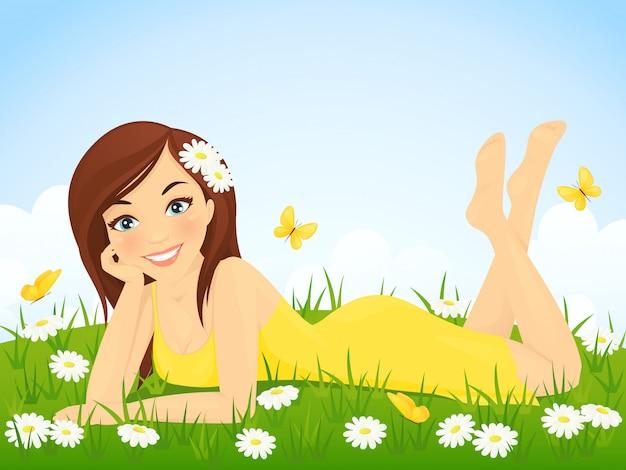 Милая девушка, лежа на лугу цветок Premium векторы