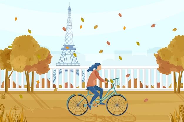 Женщина на велосипеде в париже Premium векторы