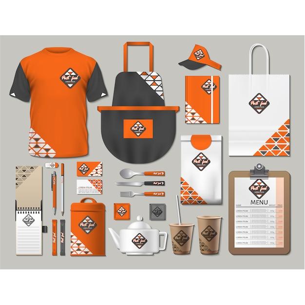 Канцелярские товары для кофе-шопов с оранжевым дизайном Бесплатные векторы