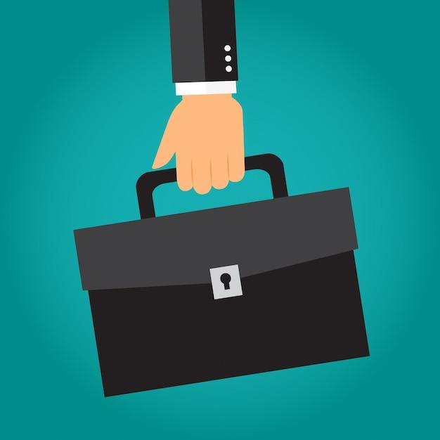 ブリーフケースやポートフォリオを持っているビジネスマンの手 Premiumベクター