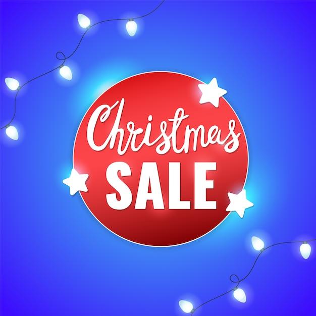 Рождественская распродажа зимний баннер со звездами, легкие гирлянды и рождественские надписи. Premium векторы