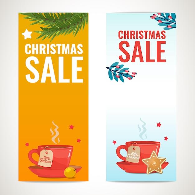 Рождественская распродажа вертикальный баннер дизайн шаблона с красной чашкой чая, еловые ветки, зимние украшения Premium векторы