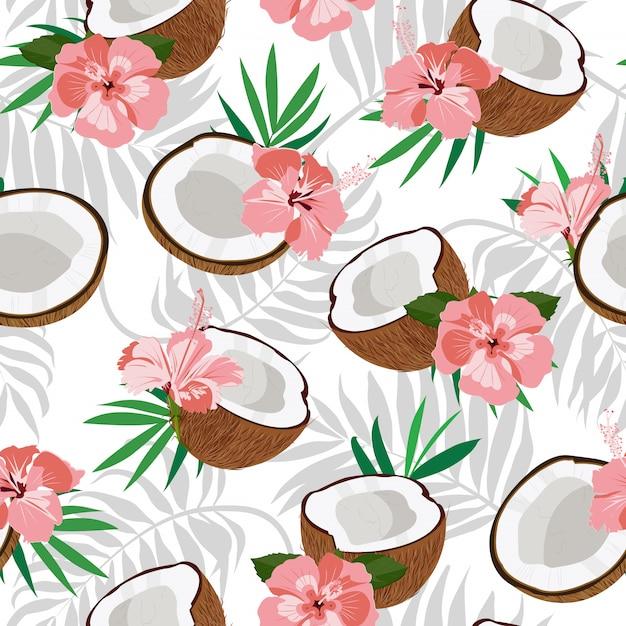 Бесшовный узор из кокоса и пальмовых листьев с розовым гибискусом Premium векторы