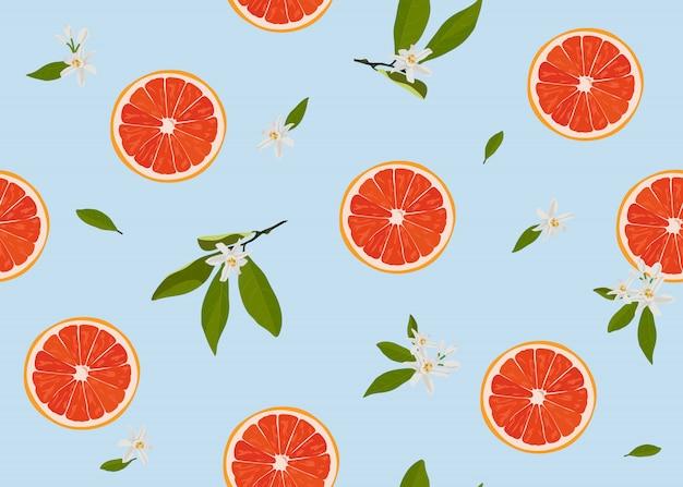 オレンジ色の果物は、花とのシームレスなパターンをスライスします。 Premiumベクター