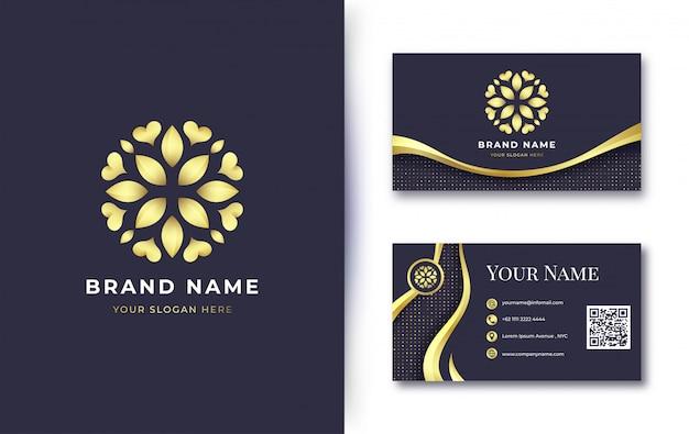 名刺テンプレートと豪華な黄金の花のロゴ Premiumベクター